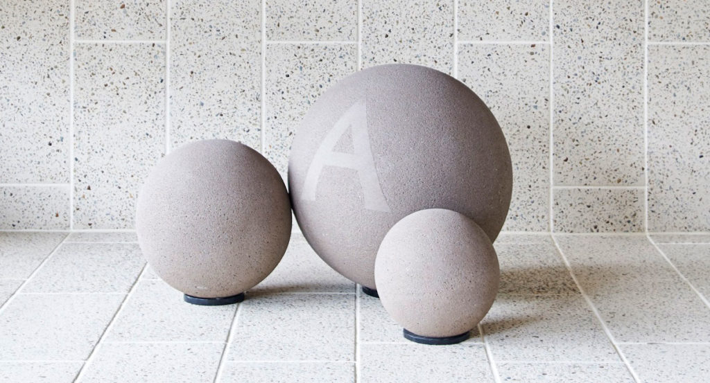 Anston spheres and Ironstone exposed aggregate paving in Ivory.